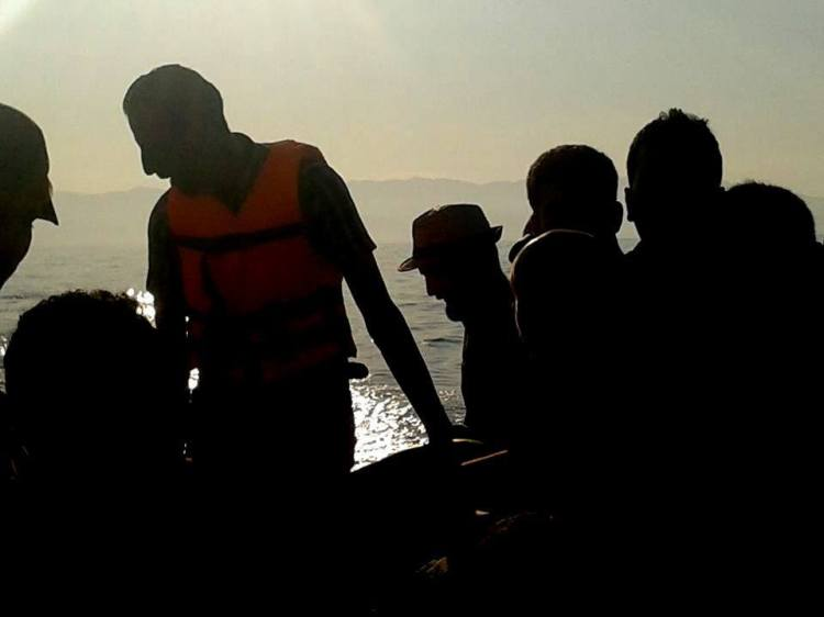 """Receiving one of those calls on the"""" floating carpet,"""" the """"Captain"""" in orange vest, my travel mates looking directly towards their future. (Taken by Hadikun)"""