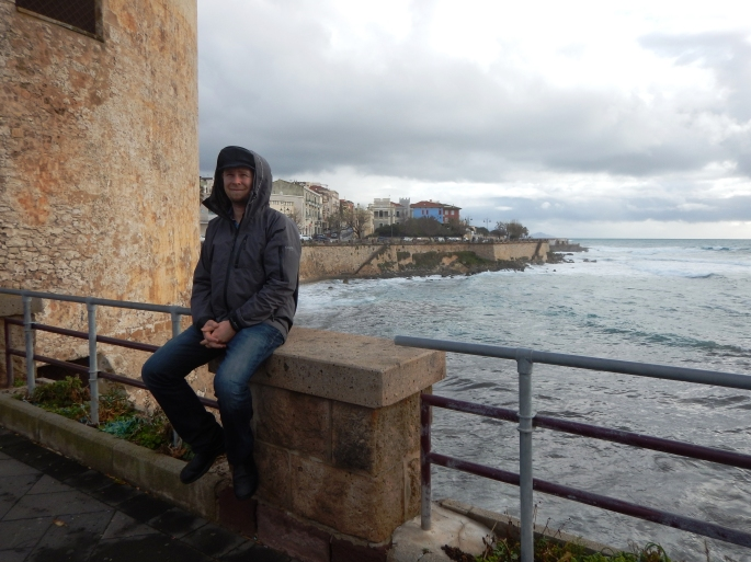 Jacob near the seaside in Alghero. A very defensible city!