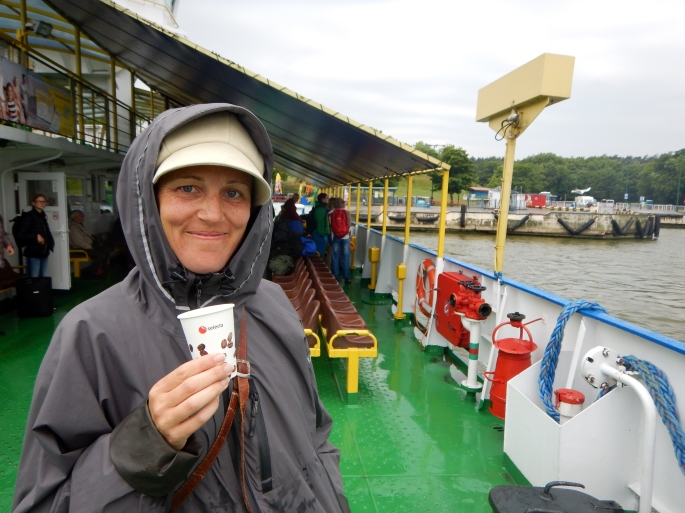 Of course I am smiling on the ferry to Klaipeda; he gave me the raincoat and the coffee!