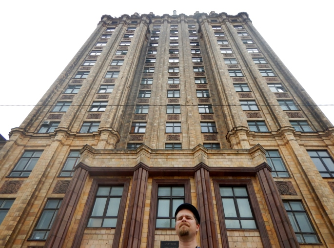 The one picture I took in Riga - my guy and a huge Soviet building.