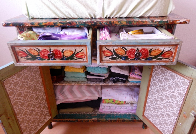 Dresser/changing table with all clothes and blankets washed line dried and ready to go.