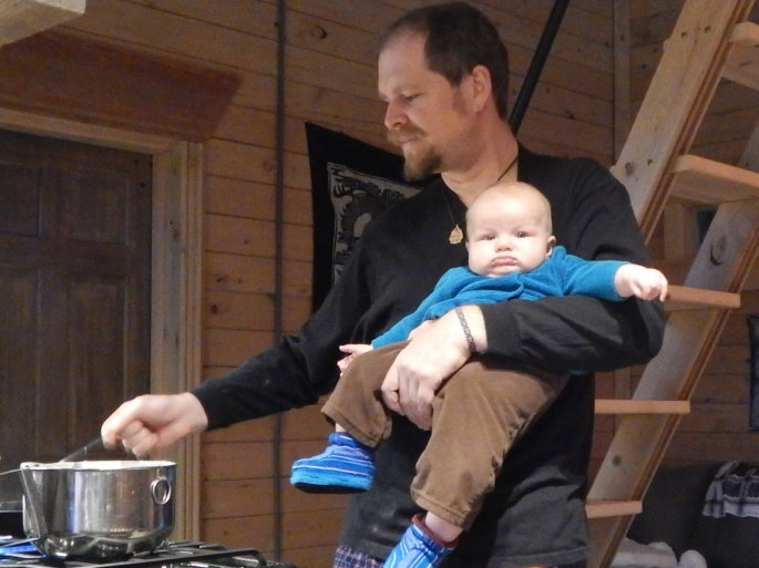 Helping Dad make pancakes
